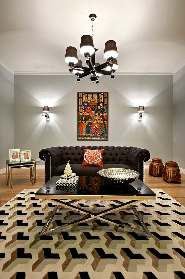 Polished chrome frame and black glass coffee table for the glam living room [Design: Sense of Style]