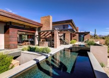 Pool area adds both to the aesthetics and temperature control of the desert home