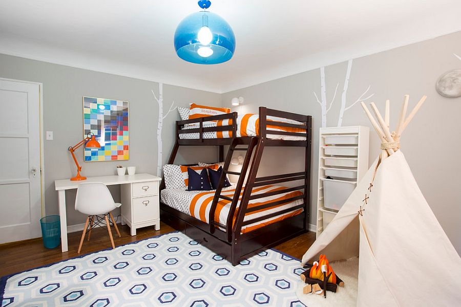 Pops of blue and orange enliven the refined boy's bedroom in gray [Design: Baiyina Hughley Interior Design]