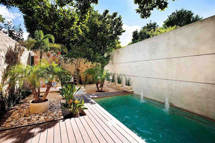 Private courtyard with deck and pool of the home in Yucatan Indoor Garden and Innovative Use of Tiles: Vibrant Home in Mérida