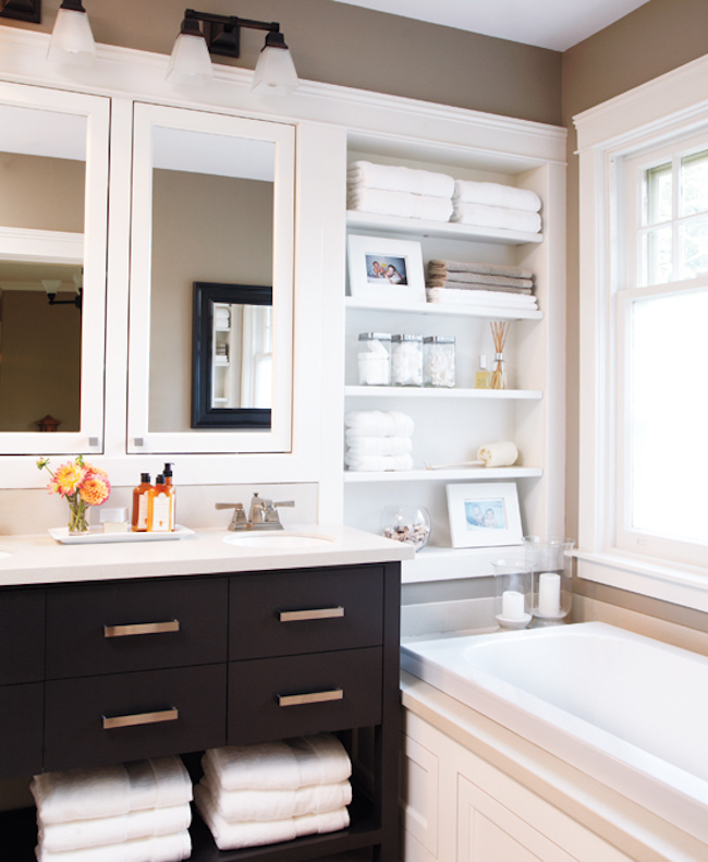 Recessed shelving beside the bathtub