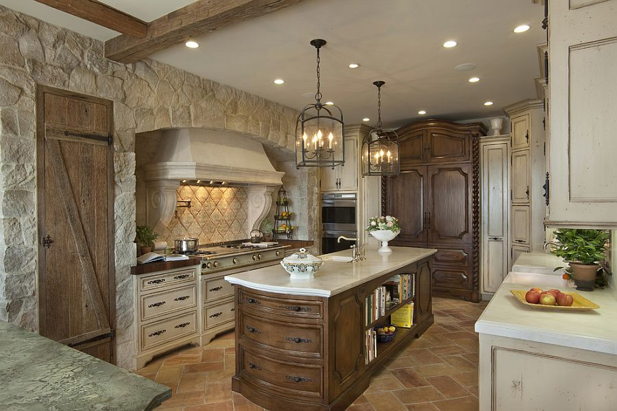 Reclaimed French stone fashions a cozy ambiance in the Mediterranean kitchen [Design: GDC Construction]