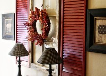 Red-shutters-and-old-window-used-as-wall-art-above-a-hall-table-217x155