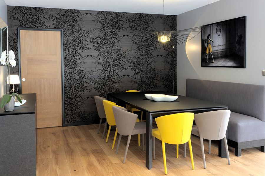 Refined contemporary dining room in gray with a dash of yellow [Design: Caroline Désert Décoratrice d'Intérieur]
