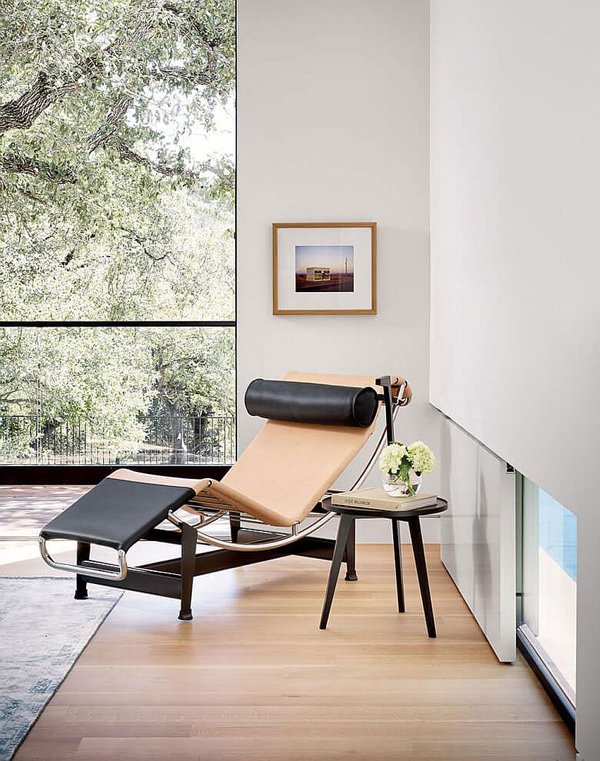 Relaxing lounger and side table create a cozy reading nook in the bedroom