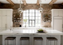 Rough-timber-beams-and-exposed-brick-walls-in-the-transitional-kitchen-217x155