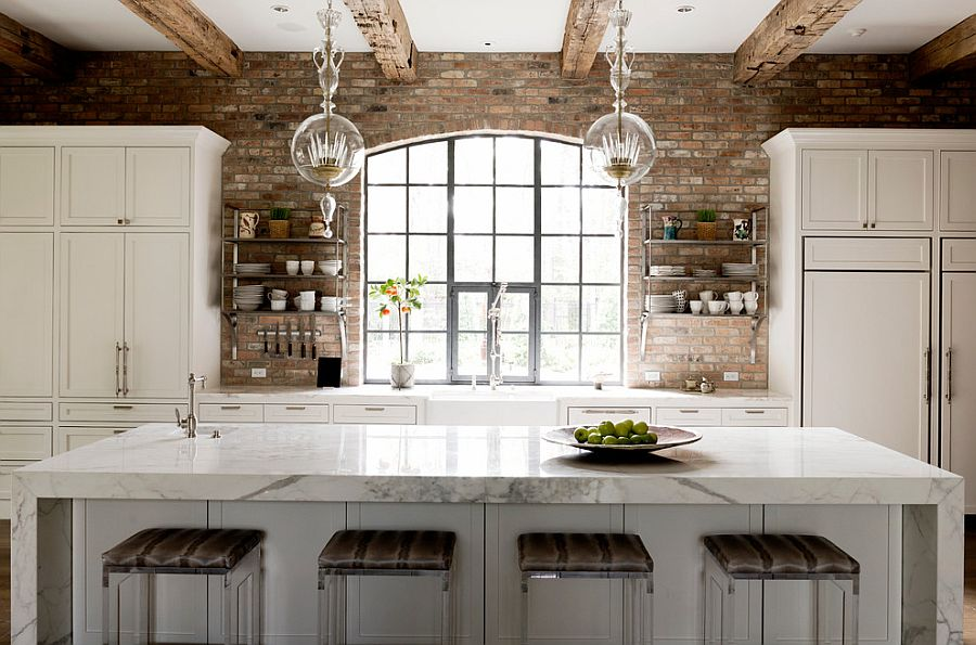 Rough timber beams and exposed brick walls in the transitional kitchen [Design: Thompson Custom Homes]