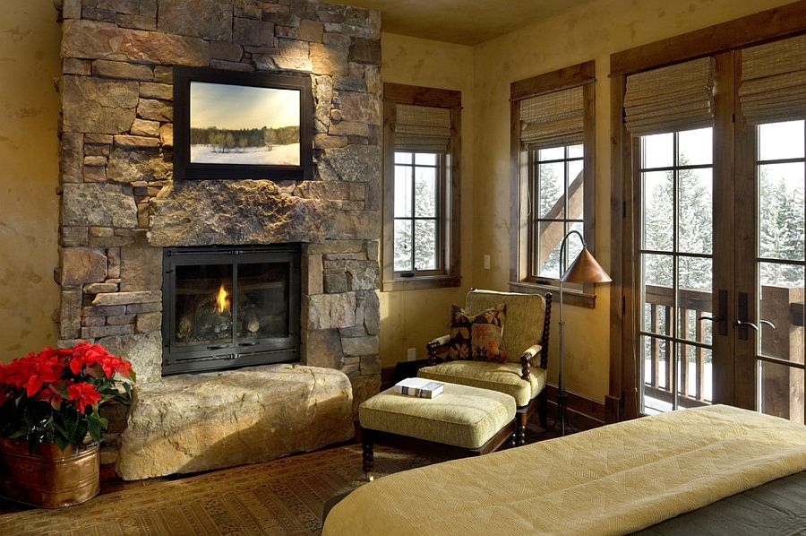 Rustic bedroom turns the stone wall into a lovely focal point [From: Design Associates]