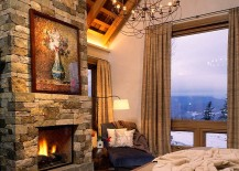 Rustic-bedroom-with-cozy-stone-fireplace-and-mountain-view-217x155