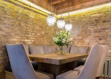Rustic-dining-space-with-brick-walls-and-custom-wooden-dining-table-217x155