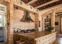 Rustic elements like Curved wood slat ceiling and brick walls give the transitional kitchen a timeless look [Design: Wynand Wilsenach Architects]