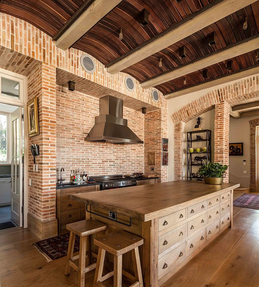 Rustic Elements Like Curved Wood Slat Ceiling And Brick