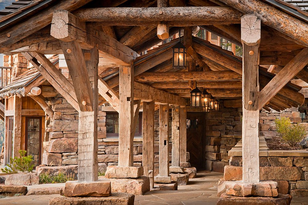 Rustic entry with lantern lighting is an absolute dream!