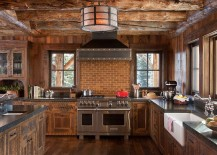 Rustic-kitchen-in-wood-and-stone-with-a-smart-brick-backsplash-217x155
