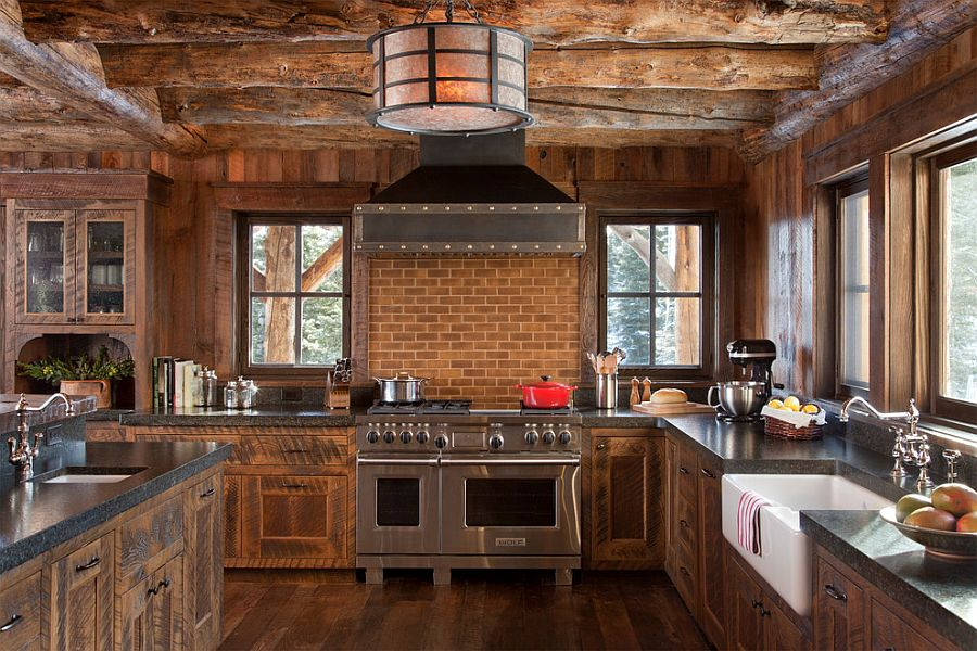 Rustic kitchen in wood and stone with a smart brick backsplash