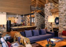 Rustic-living-room-with-stone-walls-and-high-ceiling-217x155