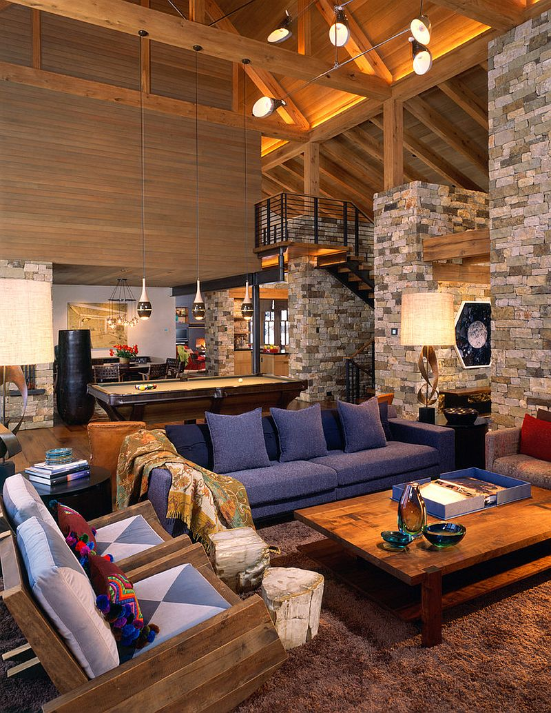 Rustic living room with stone walls and high ceiling