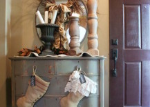 Rustic stockings hung on entryway dresser knobs 217x155 8 Festive Ways to Hang Stockings When You Dont Have a Fireplace
