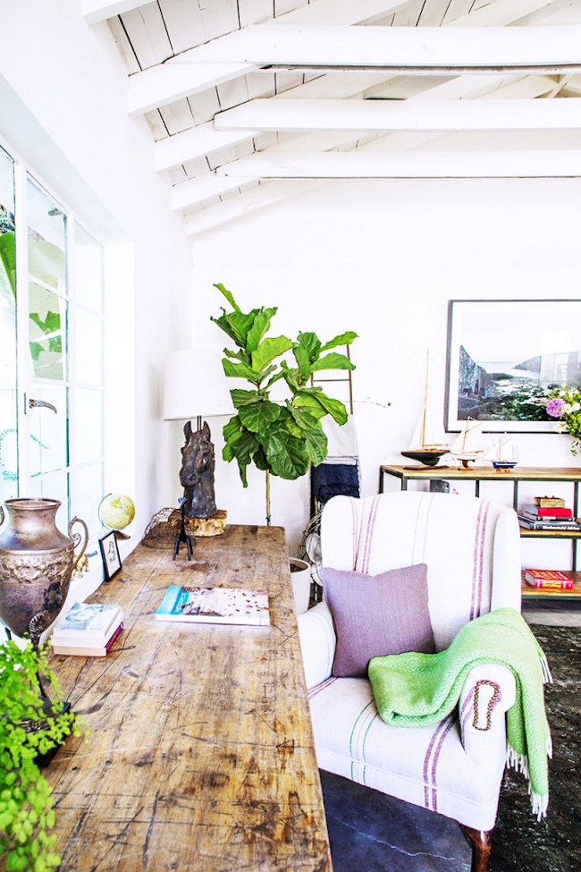Rustic wood desk in a bright office space