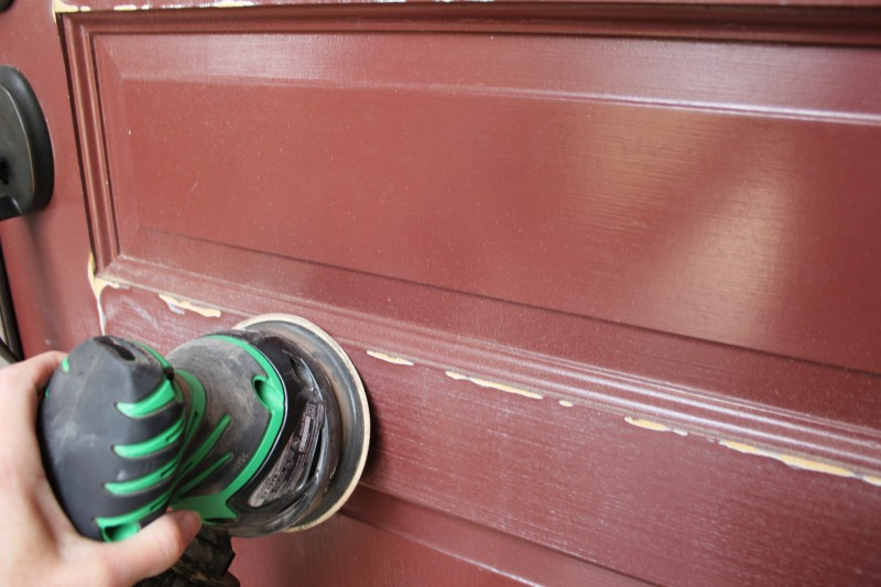 Sanding the front door (photo credit: Living on the Bliss)