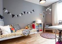 Scandinavian style kids room with an unassuming gray backdrop