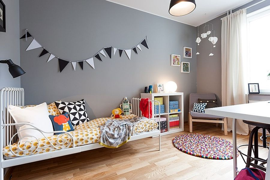Scandinavian style kids' room with an unassuming gray backdrop [Design: Moodhouse Interiör]