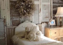 Shabby chic bedroom with entire wall full of vintage shutters