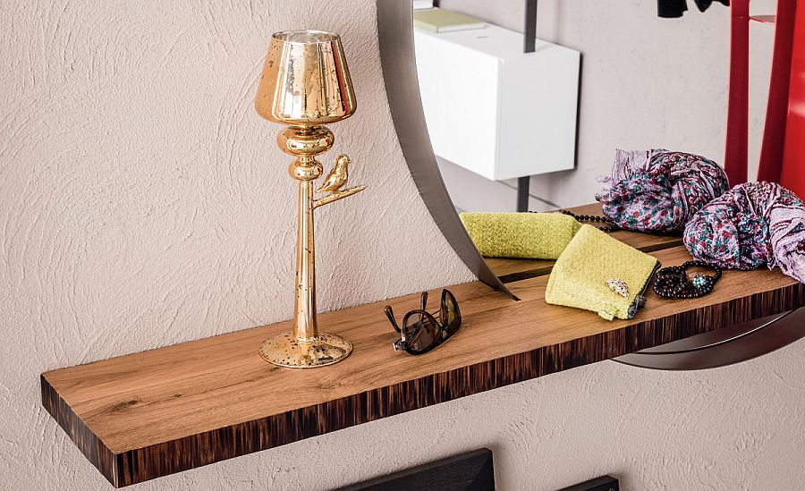 Shelf in Canaletto walnut adds to the beauty of the exclusive mirror from Cattelan Italia