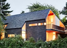 Shingle roofing material continues down the walls giving the Seattle home a classic look