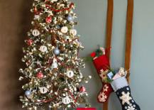 Skis-with-stockings-hung-on-them-next-to-Christmas-tree-217x155