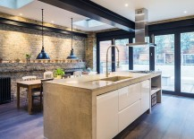 Skylight ushers in additional lighting into the kitchen [Design: COUPDEVILLE]