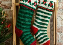 Sled-leaning-against-wall-with-Christmas-stockings-217x155