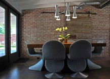 Sliding barn door and eclectic collection of chairs in the snazzy dining room [Design: The Ranch Mine]