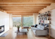 Sliding-glass-dooes-with-wooden-frames-and-sheer-curtains-open-up-the-living-room-to-the-view-outside-217x155