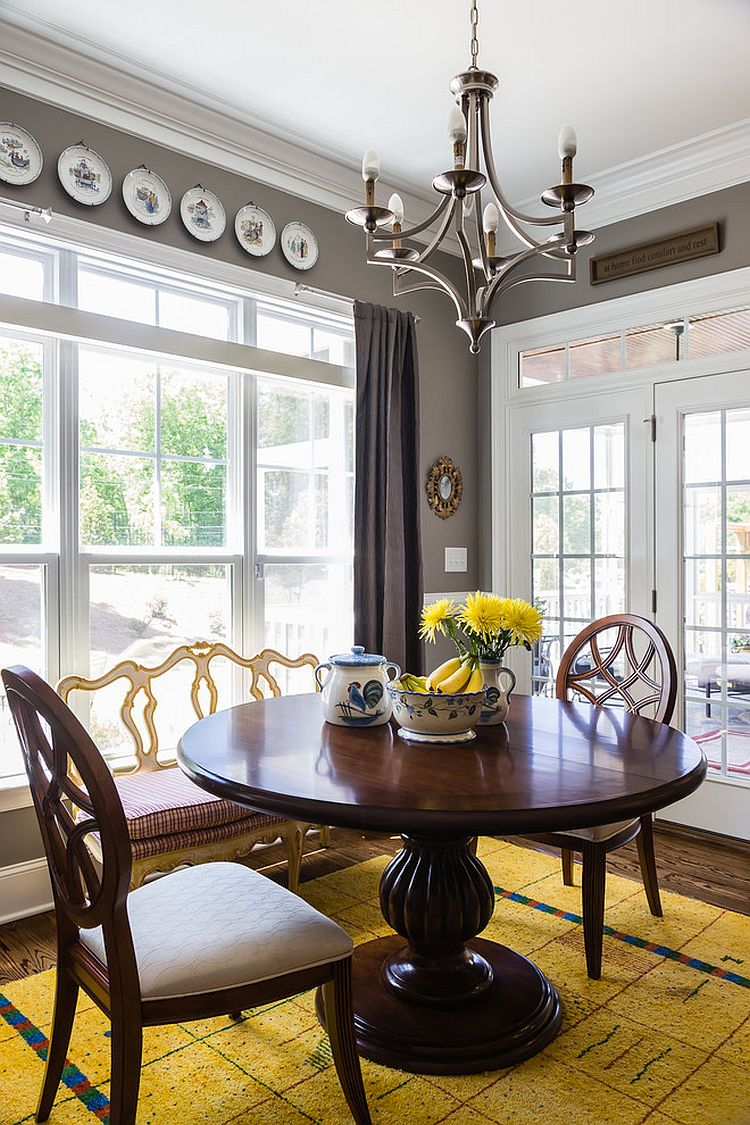 Small and stylish dining room in gray with a dash of yellow [Design: Form & Function]