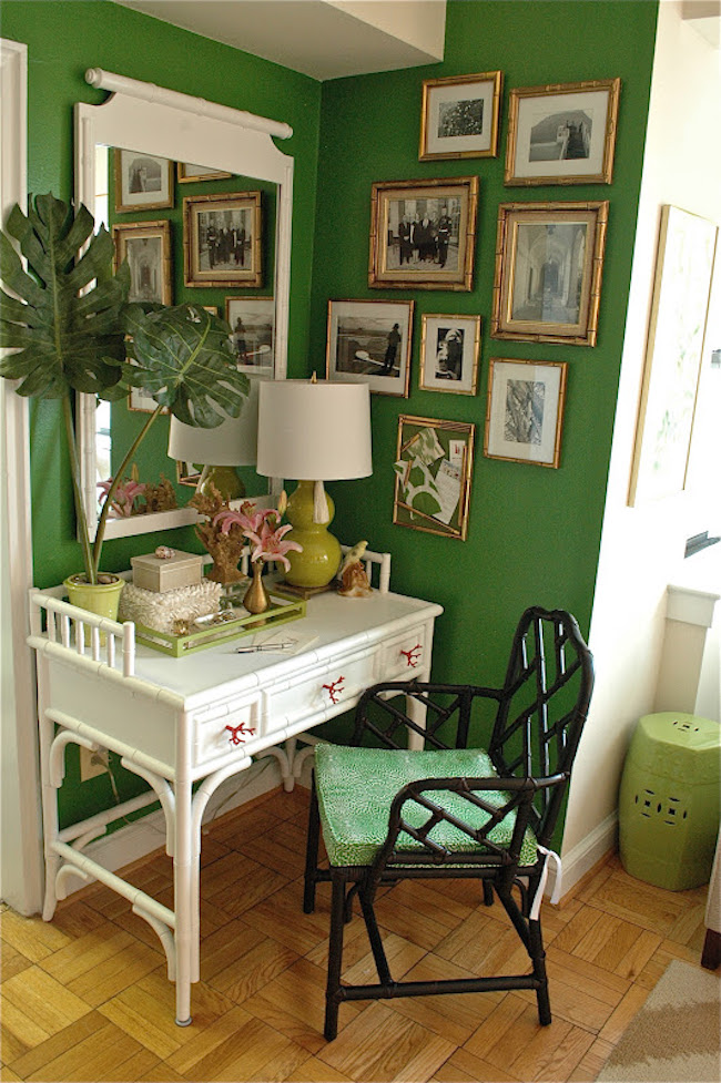 Small but serene office in a corner with a green wall