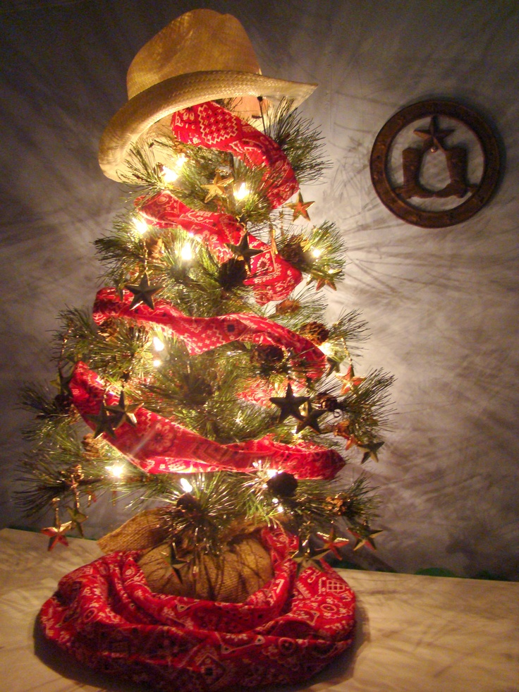 Small cowboy-themed Christmas tree with hat