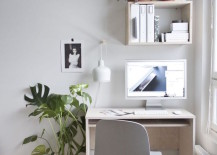 Small-desk-near-a-bright-window-with-touches-of-greenery-217x155