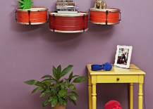 Small drums secured to wall as shelves 217x155 12 Creative Uses of Old Drums Throughout the Home