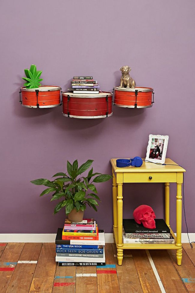 Small drums secured to wall as shelves