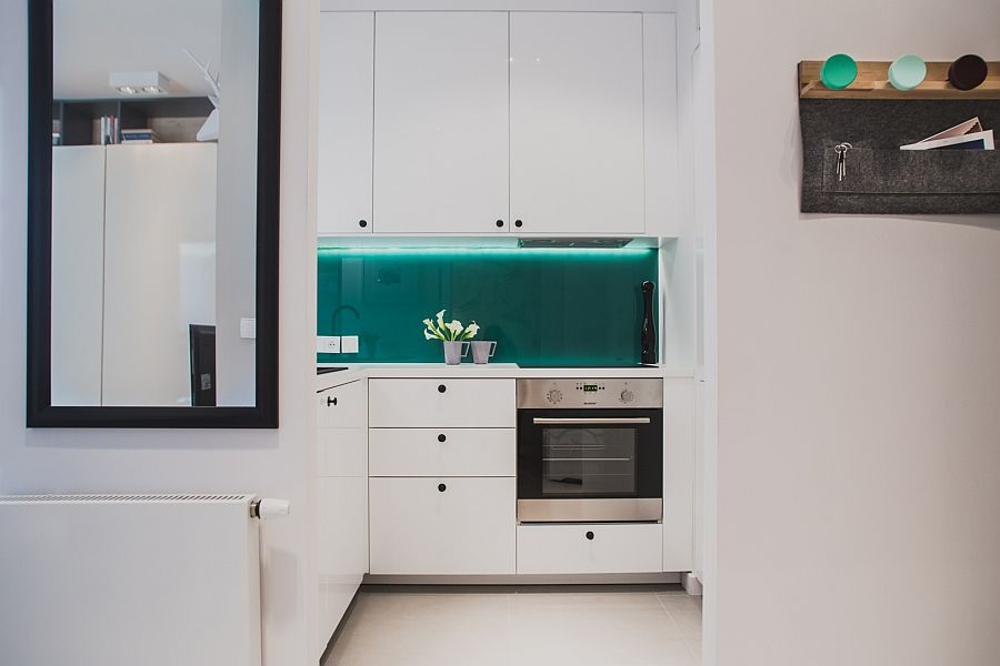 Small kitchen in white with a lovely teal backdrop