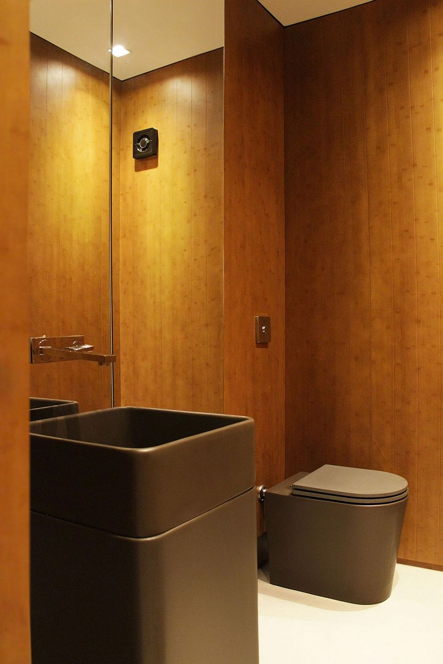 Small modern powder room deisgn with walls clad in wood