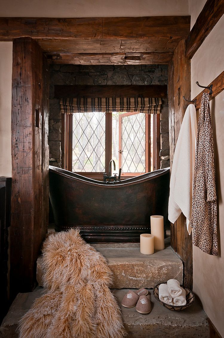 Small rustic bathroom with stone steps and a custom copper bathtub