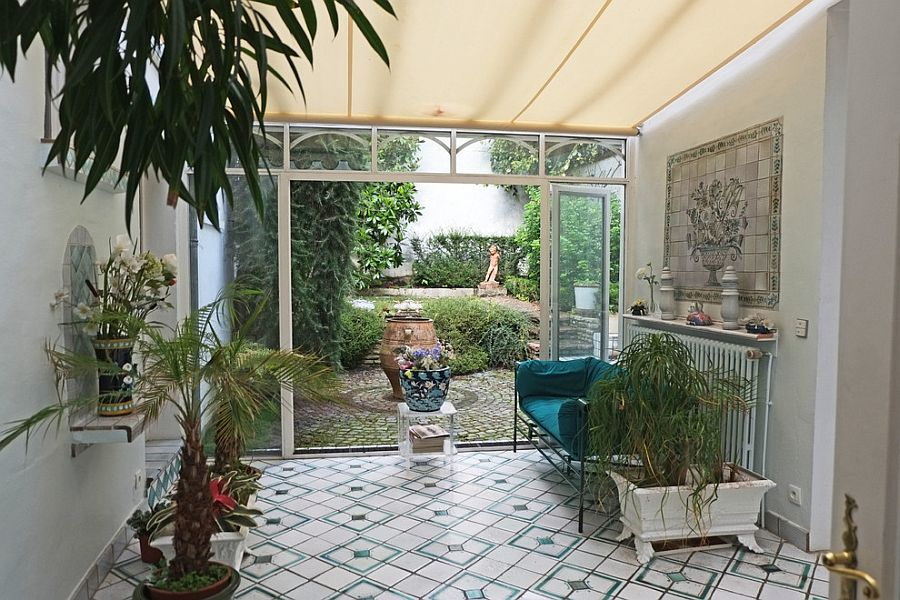 Small sunroom with Mediterranean flair and soothing ambiance [Design: Jean-Philippe Chevreau]