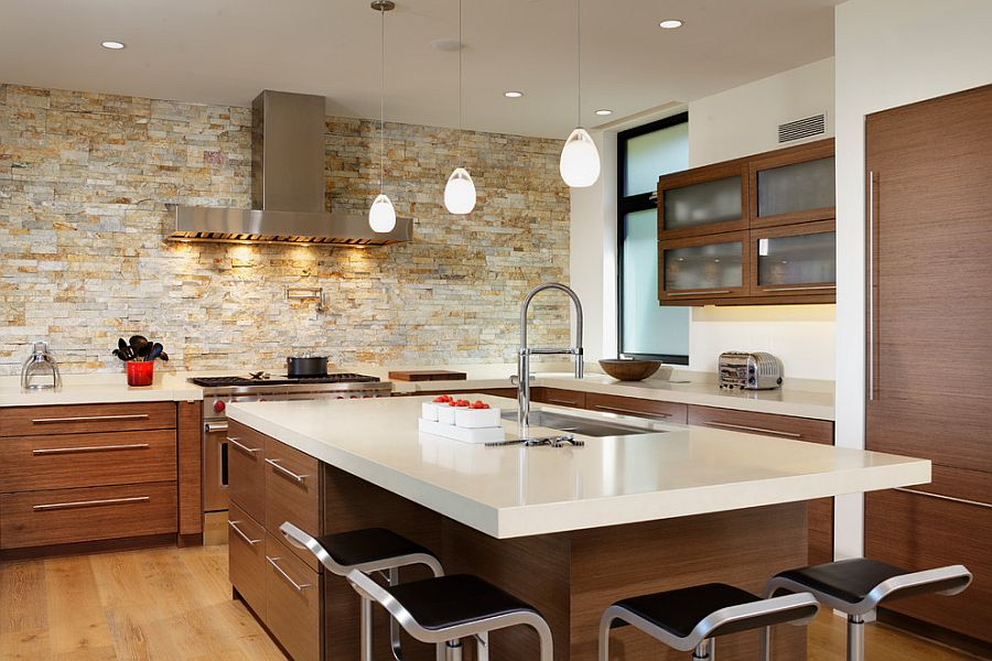 smart contemporary kitchen with lovely lighting and stone accent wall