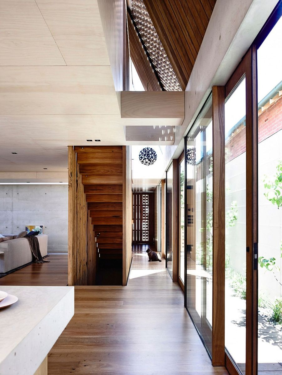 Smart design of the wooden staircase brings sculptural style even while svaing space