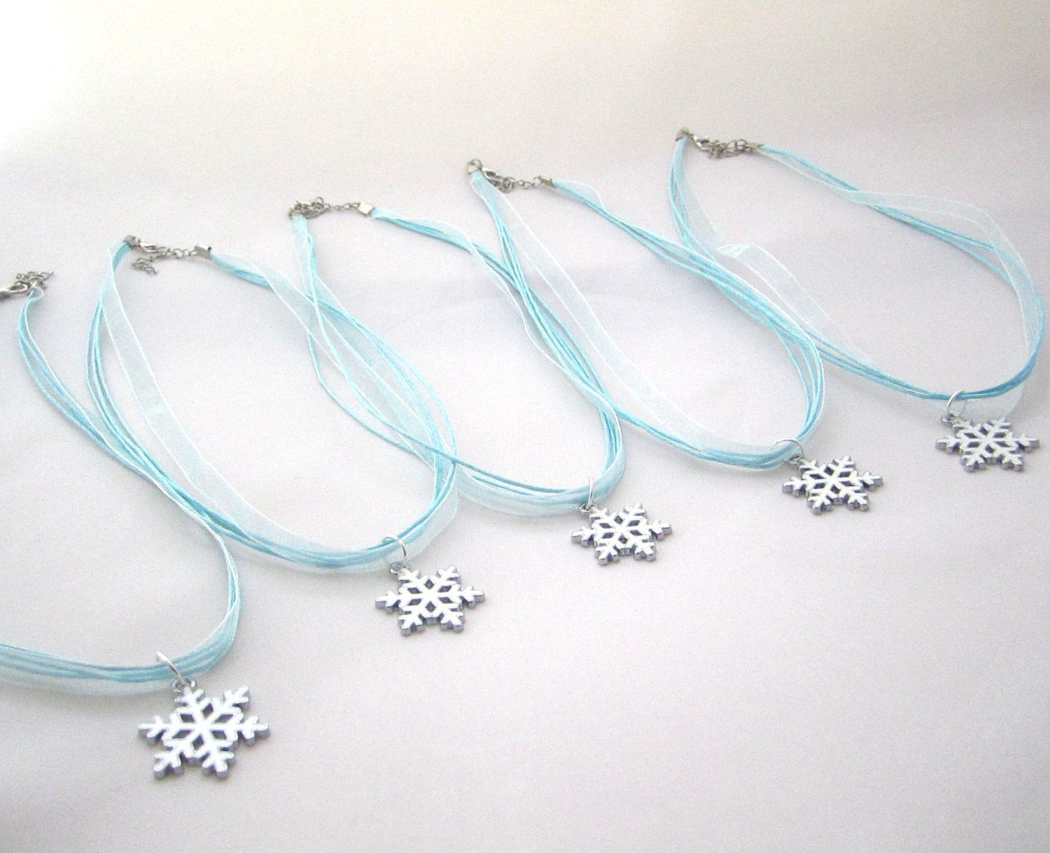 Snowflake charm necklaces from Etsy shop Favor Wrap