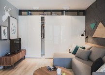 Space-saving-shelf-design-in-the-living-room-blends-into-the-backdrop-217x155