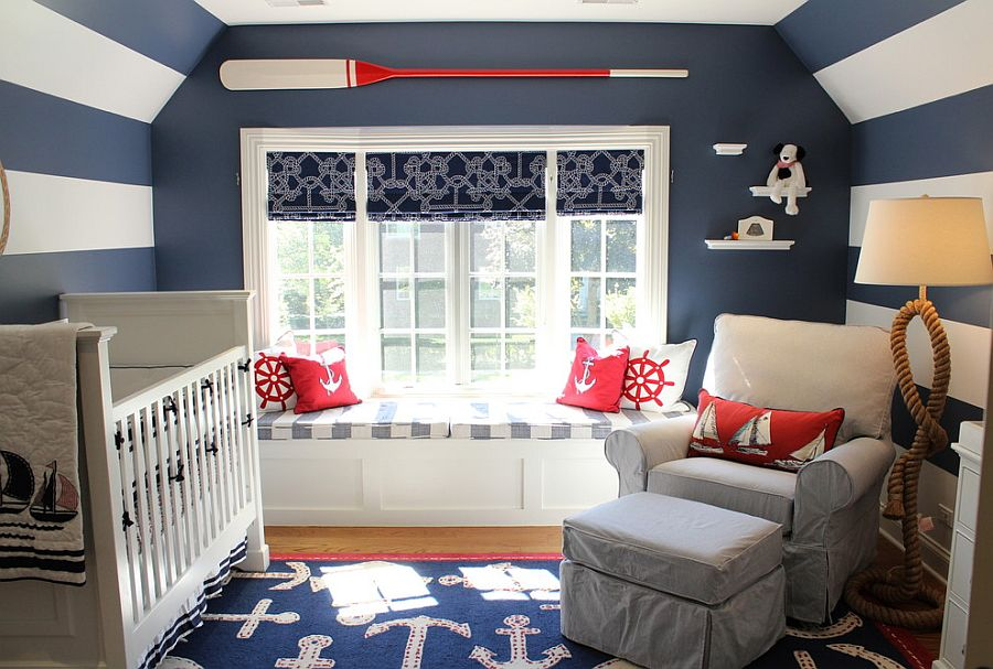 Space savvy nursery with blue and white stripes and a nautical theme