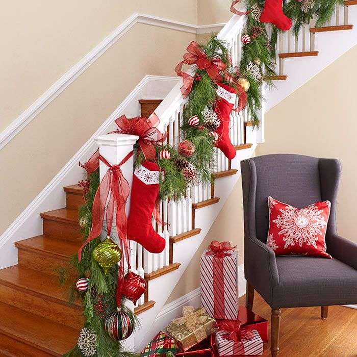 Stockings hung along the stairway banister with garland